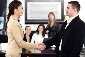 business salespeople shaking hands